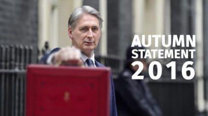 Chancellor Phillip Hammond holding red case before Autumn Statement 2016