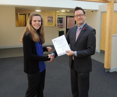 Michaela Dove of Aston Shaw receiving award for highest marks in UK for IFS exam
