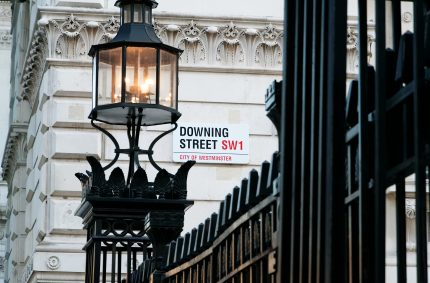 Entrance to downing street with sign on old fashioned building in background