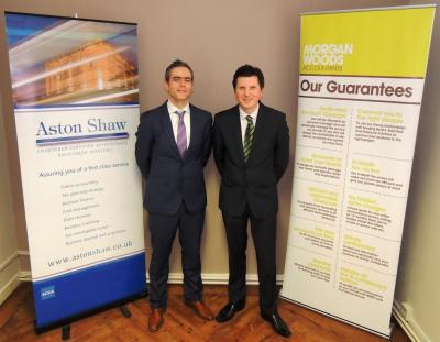 Two Accountants standing either side of their company logos after successful Merger agreement