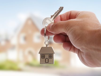 First home buyer holding the keys to a new house