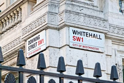 Downing street and White hall sign on old style building