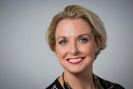 Smiling blonde female Aston Shaw employee