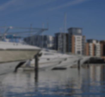 Large boats floating on river in Ipswich