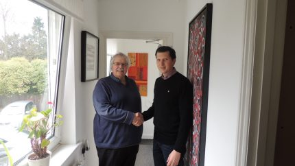 Mark Noakes shaking hands with Colin Bates, post-acquisition of JKL Consultants