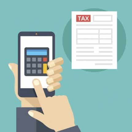 Hand holding smartphone with calculator on screen and tax form. Tax calculator, mobile app for accounting concepts. Making Tax Digial (MTD)