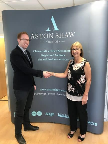 Chris Lock from Aston Shaw shakes hands with Jill Page