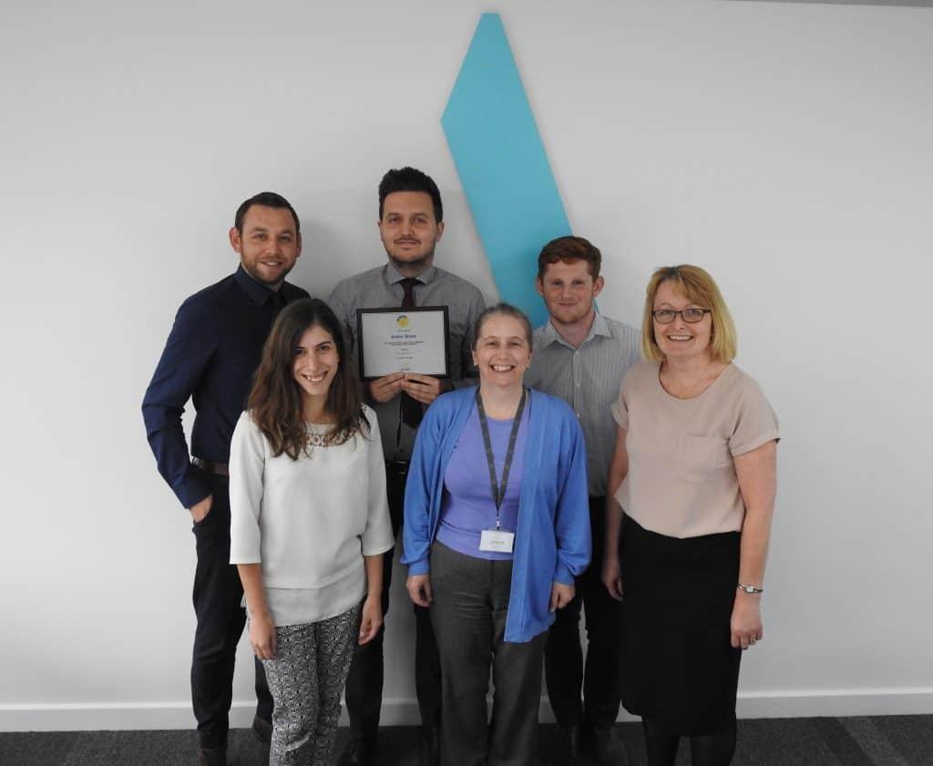 Aston Shaw Payroll Team Holding CIPP Plaque