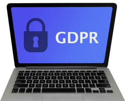 Closeup of laptop screen with GDPR and padlock - isolated on white background with clipping path