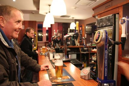 Photo of Man Stand at Bar in Pub