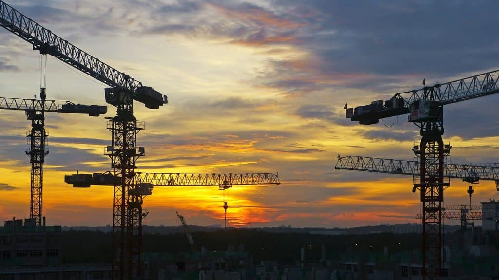 Cranes in Skyline at Sunset