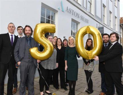 Aston Shaw Team Outside Office Holding Golden 50 Balloons