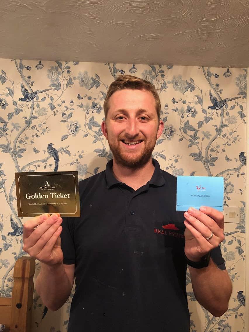 Jon Lovelock, Director of Real Estates East Anglia Ltd. Holding Golden Ticket