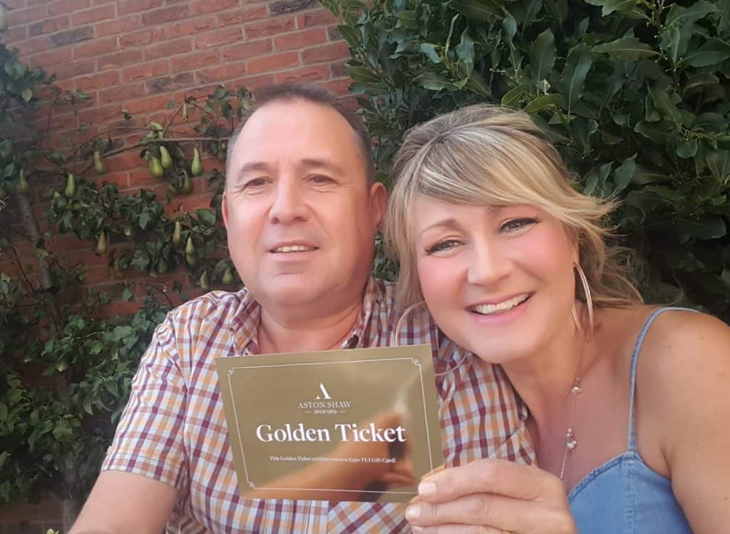 John & Elaine Holding Aston Shaw Golden Ticket