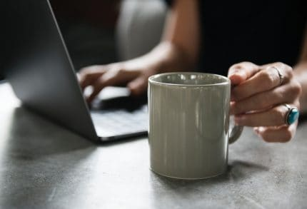 Self-employed Person Working From Coffee Shop