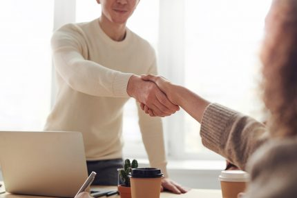 A handshake at the beginning of an interview.